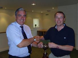 Peter Bennett presents the Steve Baker Trophy to Adrian Armitage